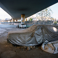 Abandoned cars under a motorway bridge during the financial crisis.