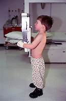 Young child having a chest x-ray taken in hospital. This image may only be used to portray the subject in a positive manner..©shoutpictures.com..john@shoutpictures.com