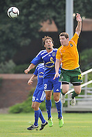 Andreas Arango (blue, minn), Mke Amberlsey...AC St Louis and NSC Minnesota Stars played to a 2-2 tie at Anheuser-Busch Soccer Park, Fenton, Missouri.