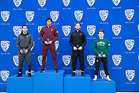 STANFORD, CA - March 7, 2020: Jared Hill of Stanford, Anthony Valencia of Arizona State University, Jackson McKinney of Oregon State University, and Dylan Miracle of Cal Poly receive awards during the 2020 Pac-12 Wrestling Championships at Maples Pavilion.