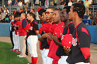 Batavia Muckdogs line up for the national anthem - (R-L), Victor Encarnacion, Jose Almarante, Hector Hernandez, Reggie Williams, and Cesar Valera - during a game against the Auburn Doubledays at Dwyer Stadium on August 27, 2011 in Batavia, New York.  Batavia defeated Auburn 7-5.  (Mike Janes/Four Seam Images)