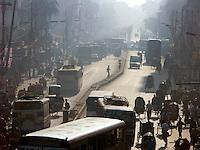 December, 2003 Three wheeled bicycle rickshaws (taxis) at work in Dacca, Bangladesh