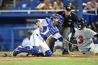 Dunedin Blue Jays  catcher Derrick Chung (1) tags shortstop Yadiel Rivera (13) sliding in as umpire Brennan Miller looks on to make the call during a game against the Brevard County Manatees on April 11, 2014 at Florida Auto Exchange Stadium in Dunedin, Florida.  Brevard County defeated Dunedin 5-2.  (Mike Janes/Four Seam Images)