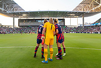 AUSTIN, TX - JUNE 16: Becky Sauerbrunn #4, Alyssa Naeher #1, Abby Dahlkemper #7 and Kelley O'Hara #5 of the USWNT huddle before a game between Nigeria and USWNT at Q2 Stadium on June 16, 2021 in Austin, Texas.