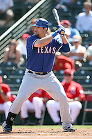 Mitch Moreland #18 of the Texas Rangers plays in a spring training game against the Los Angeles Angels at Tempe Diablo Stadium on March 8, 2011  in Tempe, Arizona. .Photo by:  Bill Mitchell/Four Seam Images.