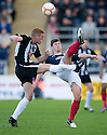 Falkirk's Stewart Murdoch clears from Pars' Ryan Thomson    ...