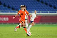 YOKOHAMA, JAPAN - JULY 30: Danielle van de Donk #10 of the Netherlands goes forward during a game between Netherlands and USWNT at International Stadium Yokohama on July 30, 2021 in Yokohama, Japan.