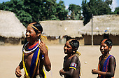 Bacaja village, Amazon, Brazil. Boys dancing with artifacts during the hornets' nest initiation ceremony; Xicrin tribe.