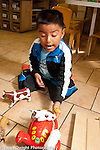Education preschool 3-4 year olds boy playing by himself with animals and vehicles talking to himself