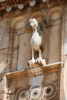 Griffin sculpture on the 12th century Romanesque facade of the Chiesa di San Pietro extra moenia (St Peters), Spoletto, Italy