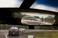 A roadblock closed a stretch of interstate 86 near Amity, NY. The area around Friendship, NY wasdeluged with state police, Corrections officers and others searching for escaped convicts after a woman reported sighting someone who matched thier description. Brendan Bannon, Amity, NY. 6/21/15.