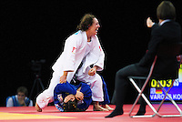 04 DEC 2011 - LONDON, GBR - Sally Conway (GBR) (top, in white) celebrates winning by Ippon in the final few seconds of the Golden Score round of her semi final contest against Laura Vargas Koch (GER) at the London International Judo Invitational and 2012 Olympic Games test event at the ExCel Exhibition Centre in London, Great Britain (PHOTO (C) NIGEL FARROW)