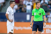 CARSON, CA - JUNE 19: Sacha Kljestan #16 of the Los Angeles Galaxy prepares to take a PK as referee Drew Fischer looks on during a game between Seattle Sounders FC and Los Angeles Galaxy at Dignity Health Sports Park on June 19, 2021 in Carson, California.