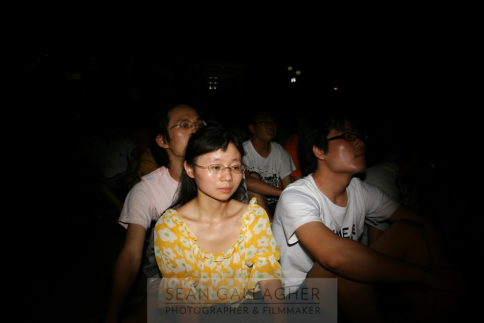 CHINA. Beijing. Members of the Chinese public watching the opening ceremony of the Beijing Summer Olympics. 2008