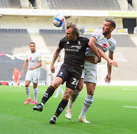 Lincoln City's Harry Anderson vies for possession with Milton Keynes Dons' Baily Cargill<br /> <br /> Photographer Chris Vaughan/CameraSport<br /> <br /> The EFL Sky Bet League One - Milton Keynes Dons v Lincoln City - Saturday 19th September 2020 - Stadium MK - Milton Keynes<br /> <br /> World Copyright © 2020 CameraSport. All rights reserved. 43 Linden Ave. Countesthorpe. Leicester. England. LE8 5PG - Tel: +44 (0) 116 277 4147 - admin@camerasport.com - www.camerasport.com