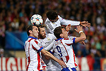Atletico de Madrid's Diego Godin and Mandzukic and Real Madrid´s Raphael Varane and Sergio Ramos during quarterfinal first leg Champions League soccer match at Vicente Calderon stadium in Madrid, Spain. April 14, 2015. (ALTERPHOTOS/Victor Blanco)