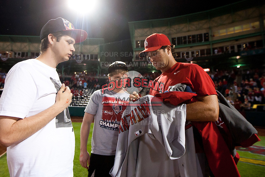 Manager Mike Matheny (22) of the St. Louis Cardinals signs a jersey for a fan after a game against the Springfield Cardinals at Hammons Field on April 2, 2012 in Springfield, Missouri. (David Welker/Four Seam Images)