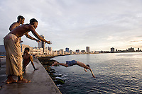 Havana, Cuba<br /> In Cuba, a country devoid of technical distractions, the vibrancy of life spills into the streets. At the end of the day men convene in the streets to play a rowdy game of dominos. Teenagers practice their steps for their upcoming Quinceañera dance, while women gossip and show off their babies. On every street corner children entertain themselves for hours playing baseball with a stick and an old bottle cap. In Havana, much of the local social life is experienced around the Malecon. The main purpose of building this wall in 1901 was to protect the city from rising ocean water, but this esplanade has become a haven for fisherman, a promenade for lovers and a social gathering place for friends.