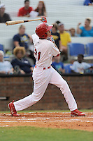 Center fielder Carlos Torres (21) of the Johnson City Cardinals bats in a game against the Elizabethton Twins on Sunday, July 27, 2014, at Howard Johnson Field at Cardinal Park in Johnson City, Tennessee. The game was suspended due to weather in the fifth inning. (Tom Priddy/Four Seam Images)