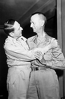 General of the Army Douglas MacArthur and Lt. Gen. Jonathan Wainwright greet each other at the New Grand Hotel, Yokohama, Japan, August 31, 1945, in their first meeting since they parted on Corregidor more than three years before. (Army)<br /> NARA FILE #:  111-SC-210621<br /> WAR & CONFLICT #:  752