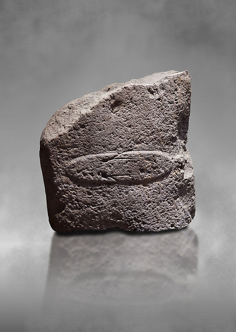Fragment of a Late European Neolithic prehistoric Menhir standing stone with acarving of a horizontal knife on its face side.   Excavated from Montes I, Laconi. Menhir Museum, Museo della Statuaria Prehistorica in Sardegna, Museum of Prehoistoric Sardinian Statues, Palazzo Aymerich, Laconi, Sardinia, Italy