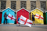 BNPS.co.uk (01202) 558833. <br /> Pic: CorinMesser/BNPS<br /> <br /> Pictured: Leo Doherty, 4, shows his support with brothers Joe, 17, and, right, Olly, 15. <br /> <br /> England fans visiting the beaches of Bournemouth, Dorset show their support for the team ahead of the Euro 2020 semi-final against Denmark