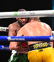 """MIAMI GARDENS, FLORIDA - JUNE 06: Former world welterweight Floyd """"Money"""" Mayweather exchanges blows with YouTube personality Logan """"Maverick"""" Paul (yellow shorts) during their contracted eight-round exhibition boxing match at Hard Rock Stadium on June 06, 2021 in Miami Gardens, Florida. ( Photo by Johnny Louis / jlnphotography.com )"""
