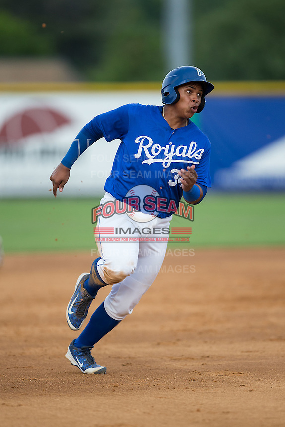 Xavier Fernandez (34) of the Burlington Royals hustles towards third base against the Danville Braves at Burlington Athletic Park on July 12, 2015 in Burlington, North Carolina.  The Royals defeated the Braves 9-3. (Brian Westerholt/Four Seam Images)