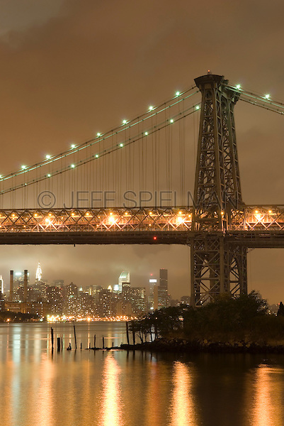 AVAILABLE FROM JEFF AS A FINE ART PRINT.<br /> <br /> AVAILABLE FROM PLAINPICTURE FOR COMMERCIAL AND EDITORIAL LICENSING.  Please go to www.plainpicture.com and search for image # p5690110.<br /> <br />  Williamsburg Bridge, East River and Midtown Manhattan Skyline on a Overcast Night, Viewed from the Williamsburg neighborhood of Brooklyn, New York City, New York State, USA