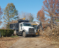 Marc Hayot/Herald Leader The Benton County Road Department sent crews down to the Edgewood subdivision to remove trees and other organic debris that were the result of the Oct. 21 tornadoes.