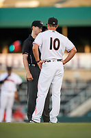 Jupiter Hammerheads manager Kevin Randel (10) talks with umpire Tanner Dobson during a game against the Palm Beach Cardinals on August 4, 2018 at Roger Dean Chevrolet Stadium in Jupiter, Florida.  Palm Beach defeated Jupiter 7-6.  (Mike Janes/Four Seam Images)