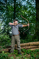 BNPS.co.uk (01202 558833)<br /> Pic: MaxWillcock/BNPS<br /> <br /> Pictured: Jonathan Hodgson in a forest near Crewkerne, Somerset.<br /> <br /> A skilled fletcher has set up a business making artistic and competition arrows after being inspired by Lord of the Rings.<br /> <br /> Jonathan Hodgson adopts Medieval techniques to fashion them out of sustainable timbers, using precious stones for the arrow head.<br /> <br /> The feathers are humanely collected from turkey or geese and bound on with silk in a process which takes several days.<br /> <br /> The 37 year old, from Ilminster, Somerset, made his first arrows out of bamboo and slate as a child living in a farmhouse with plenty of land.