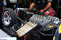 Apr 25, 2014; Baytown, TX, USA; A crew member works on the engine in the pits of NHRA funny car driver Tony Pedregon during qualifying for the Spring Nationals at Royal Purple Raceway. Mandatory Credit: Mark J. Rebilas-
