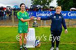 Kerry captain Áine O'Connor receives the Muster Junior Championship cup from Carmel Harkin, Secretary of the Munster Camogie Association