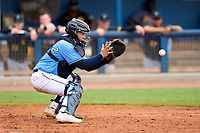 FCL Rays catcher Roberto Alvarez (91) fields a throw during a game against the FCL Pirates Black on August 3, 2021 at Charlotte Sports Park in Port Charlotte, Florida.  (Mike Janes/Four Seam Images)