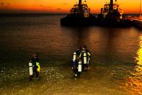 scuba divers, shore night diving, Bonaire, ABC Islands, Netherland Antilles, Caribbean Sea, Atlantic Ocean