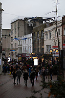 BNPS.co.uk (01202 558833)<br /> Pic: PhilYeoimans/BNPS<br /> <br /> Old Christchurch Road in Bournemouth - three strands of light of which only two are working...<br /> <br /> Are these Britain's worst Christmas lights?<br /> <br /> Traders have slammed a council's 'horrible' Christmas lights on a high street at a seaside resort.<br /> <br /> The underwhelming display features three sorry strands of lights which hang above a road in Bournemouth, Dorset.<br /> <br /> They say that one of the strands of lights, which are nearly 20 years old, does not work.<br /> <br /> Shop owners on the stretch of road have labelled them 'unacceptable' in light of the hefty business rates they pay to Bournemouth, Christchurch and Poole Council (BCP).