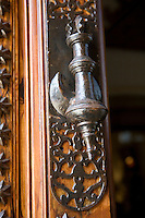 A heavy iron door handle on a wooden door at the Parador hotel, Hostal dos Reis Catolicos
