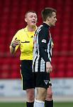 St Johnstone v Dunfermline....25.02.12   SPL.Ref Brian Colvin gives Paul Willis a talking to.Picture by Graeme Hart..Copyright Perthshire Picture Agency.Tel: 01738 623350  Mobile: 07990 594431
