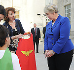 Escape Family Resource Center CEO Lidya Osadchey shows Mayor Annise Parker her super hero cape on the steps of City Hall Monday April 13, 2015. The presentation came before Mayor Parker's reading of a proclamation of April as Child Abuse Prevention Month.(Dave Rossman photo)