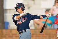 Gunner Glad #11 of the Elizabethton Twins follows through on his swing against the Johnson City Cardinals at Howard Johnson Field July 3, 2010, in Johnson City, Tennessee.  Photo by Brian Westerholt / Four Seam Images