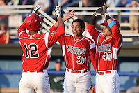 Batavia Muckdogs Kevin Grove (12) is congratulated by Carlos Duran (30) and Victor Castro (40) after hitting his first professional home run during a game against the Jamestown Jammers on July 25, 2014 at Dwyer Stadium in Batavia, New York.  Batavia defeated Jamestown 7-2.  (Mike Janes/Four Seam Images)