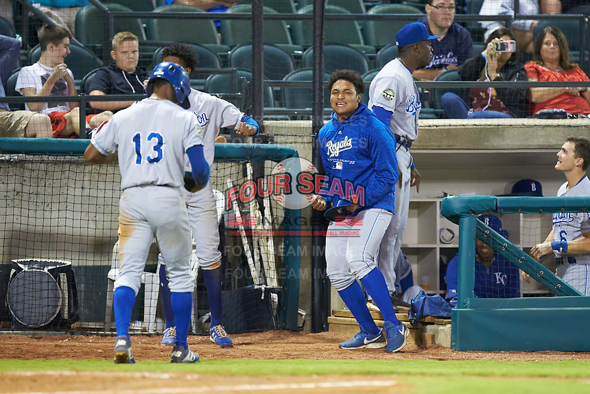 Heribert Garcia of the Burlington Royals celebrates after Jay Charleston (13) scored the go ahead run against the Pulaski Yankees at Calfee Park on September 1, 2019 in Pulaski, Virginia. The Royals defeated the Yankees 5-4 in 17 innings. (Brian Westerholt/Four Seam Images)