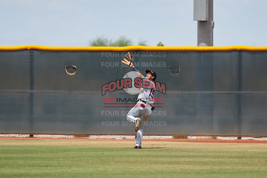 AZL Indians Red right fielder Jean Montero (15) pursues a fly ball during an Arizona League game against the AZL Indians Blue on July 7, 2019 at the Cleveland Indians Spring Training Complex in Goodyear, Arizona. The AZL Indians Blue defeated the AZL Indians Red 5-4. (Zachary Lucy/Four Seam Images)