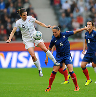 Heather O'Reilly (l) of team USA and Ophelie Meilleroux of team France during the FIFA Women's World Cup at the FIFA Stadium in Moenchengladbach, Germany on July 13th, 2011.