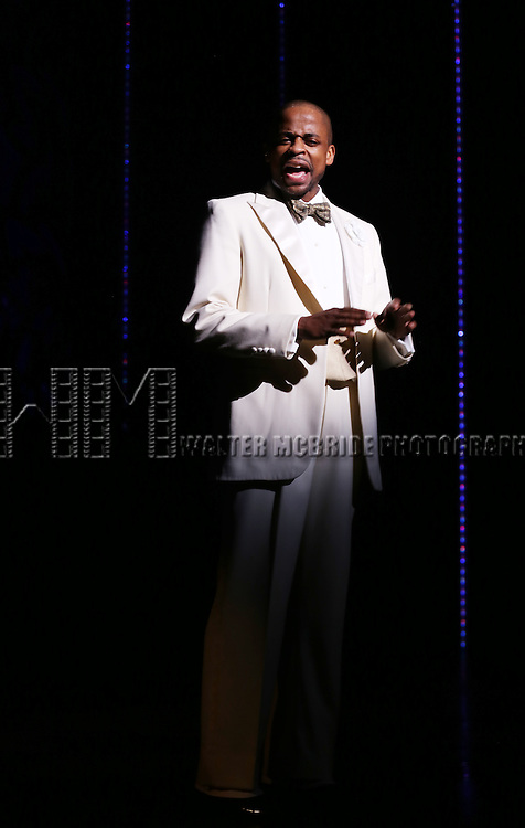 """Dule Hill announces k.d. lang as she performs a special rare """"After Midnight"""" encore performance of her legendary rendition of the Leonard Cohen classic, """"Hallelujah"""" to raise money for the Actor's Fund at the Brooks Atkinson Theater on March 7, 2014 in New York City."""