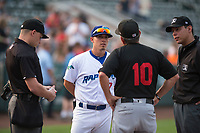 Ogden Raptors manager Jeremy Rodriguez (7) meets with Great Falls Voyagers manager Tim Esmay (10), home plate umpire Bobby Tassone (left) and umpire Rene Gallegos before a Pioneer League game against the Great Falls Voyagers at Lindquist Field on August 23, 2018 in Ogden, Utah. The Ogden Raptors defeated the Great Falls Voyagers by a score of 8-7. (Zachary Lucy/Four Seam Images)