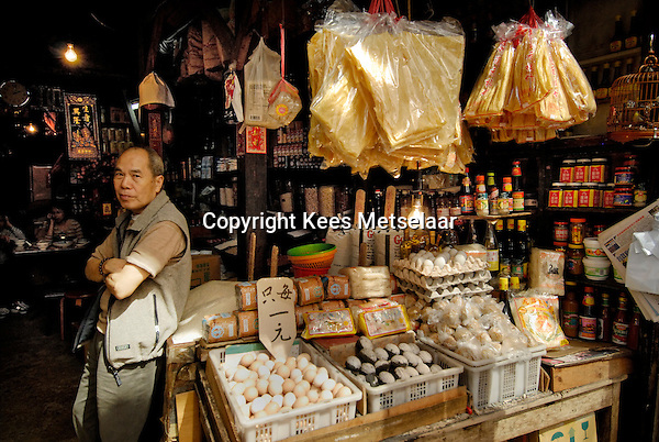 Hong Kong, 27 Feb. 2007..Kwan Moon-chui, who operates the Wing Woo  grocery and preserved-food store. The oldest, 135 years, building at the corner of Wellington Street and Graham Street. Now closed.<br /> Photo Kees Metselaar