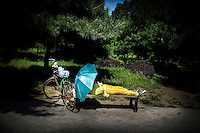 A Chinese woman rests in a park in Shenyang, China, Aug. 15, 2008 during the Olympics...Photo by Roberto Candia