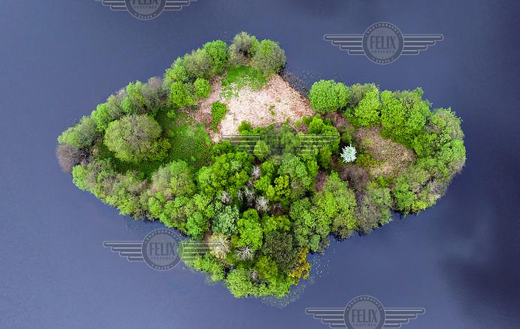 Smal island on Marchowskie Lake near Gdynia in northern Poland.